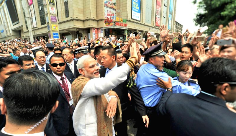 Xi`an: Prime Minister Narendra Modi interacts with the people near the Da Xing Shan Temple, in Xi`an, Shaanxi Province, China on May 14, 2015. - Narendra Modi