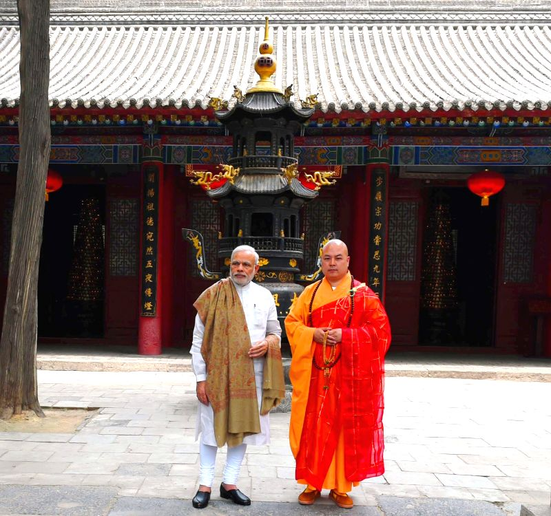 Xi`an: Prime Minister Narendra Modi visits the Da Xing Shan Temple, in Xi`an, Shaanxi Province, China on May 14, 2015. - Narendra Modi