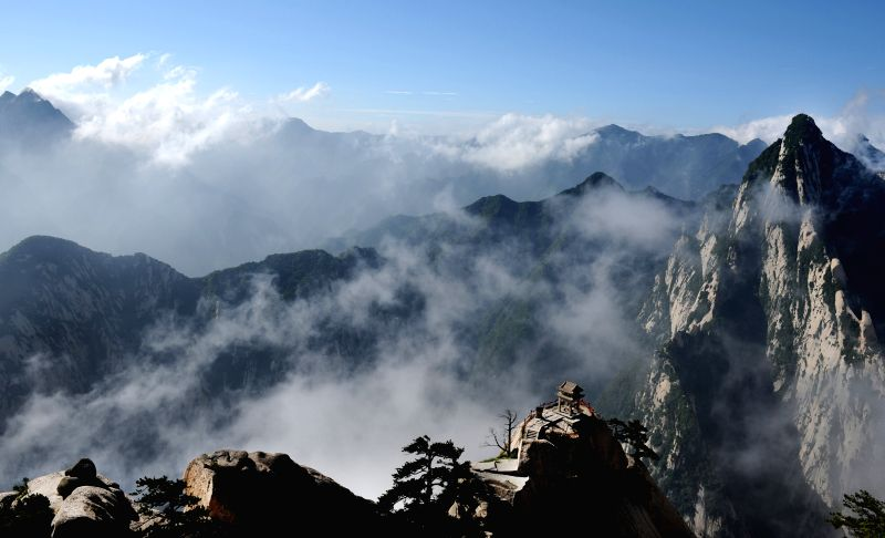 XI'Photo taken on July 1, 2015 shows the mist shrouded scenery of Huashan Mountain, northwest China's Shaanxi Province. Mount Huashan is one of China's five most famous ...