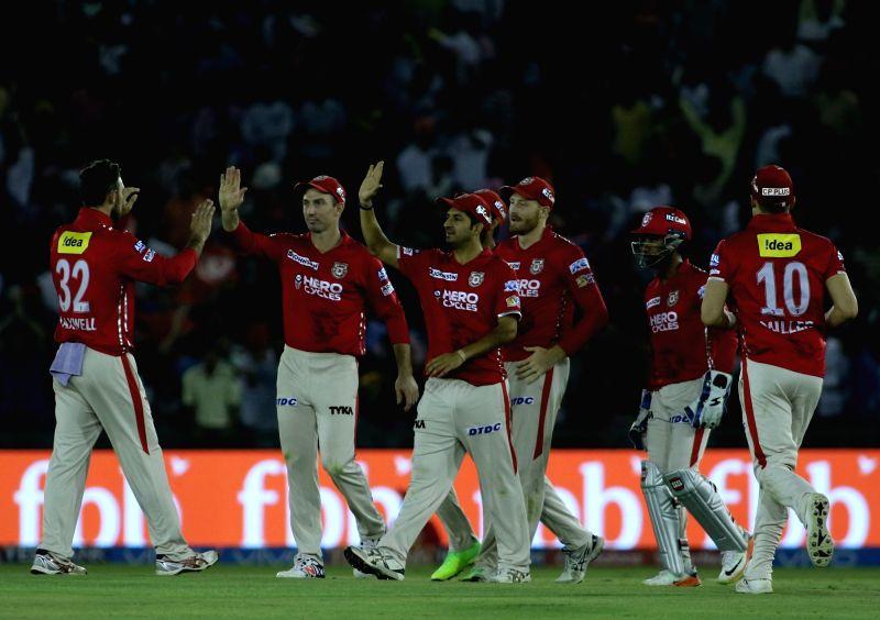 XI Punjab players celebrate fall of a wicket during an IPL 2017 match between Kings XI Punjab and Gujarat Lions at Punjab Cricket Association IS Bindra Stadium in Mohali, Punjab on May 7, ...