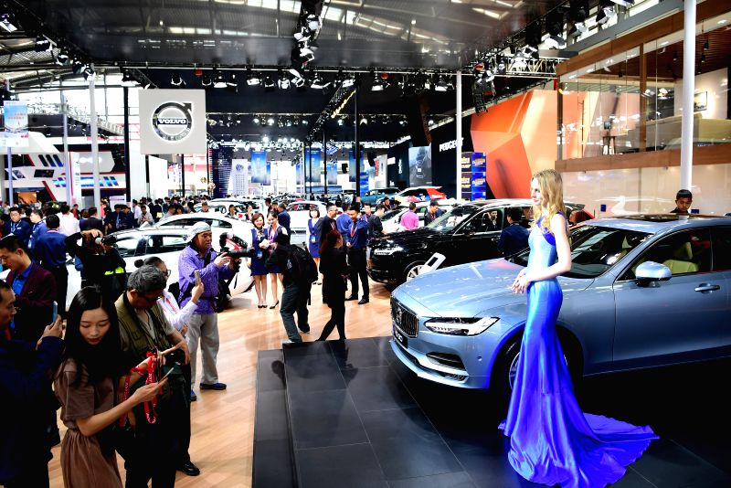 XI'Visitors look at a Volvo sedan at an auto show in Xi'an, capital of northwest China's Shaanxi Province, April 28, 2017.