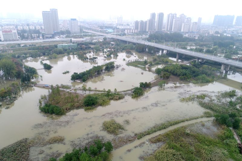 XIANGYANG, Oct. 6, 2017 - Aerial photo taken on Oct. 6, 2017 shows the Yueliangwan Wetland Park submerged by water in Xiangyang, central China's Hubei Province. Recent rainfall has caused flooding of ...
