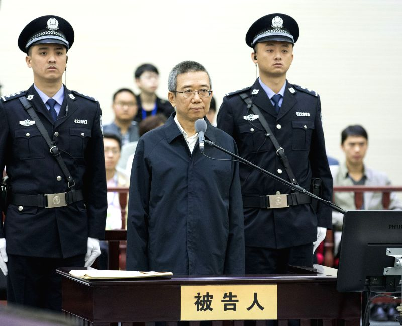 Former vice chief of the Sichuan Provincial Committee of the Communist Party of China Li Chuncheng stands trial at the Xianning Municipal Intermediate People's ...