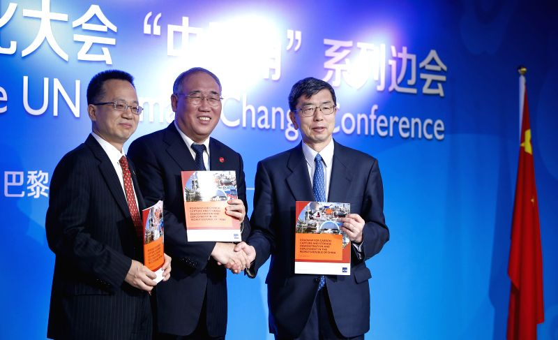 Xie Zhenhua (C), China's special representative on climate change, Yang Yingming (L), Deputy Director-General of the Department of International Economic and Finance ...