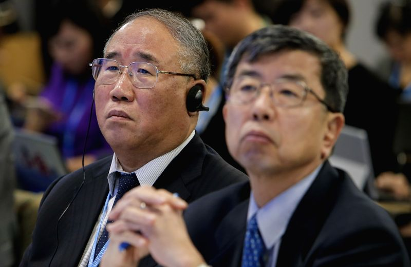 Xie Zhenhua (L),  China's special representative on climate change, listens during the China-ADB Cooperation on Climate Change Side Event on the sidelines of the 2015 ...