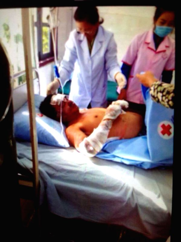 Photo taken from television on May 17, 2014 shows a survivor from a crashed aircraft in Laos' northeast province of Xieng Khouang. At least five people were ...