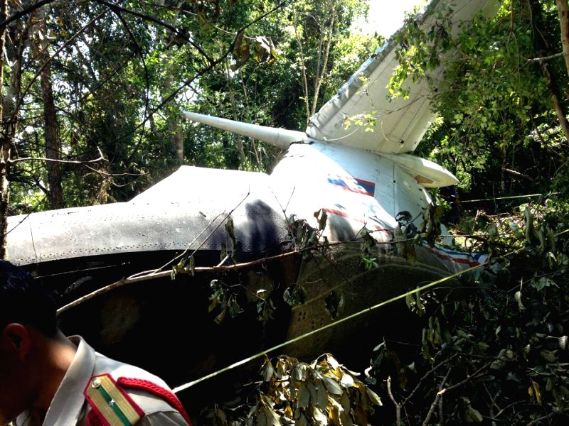 Photo taken on May 17, 2014 shows debris of a crashed aircraft in Laos' northeast province of Xieng Khouang. At least five people were confirmed dead and three
