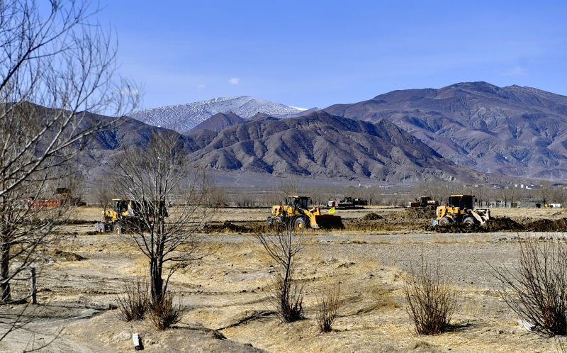XIGAZE, March 1, 2020 (Xinhua) -- Agricultural machines work at the construction site of high-standard farmland in Natang village of Qumig in Xigaze, southwest China's Tibet Autonomous Region, March 1, 2020. The local government promotes the construc