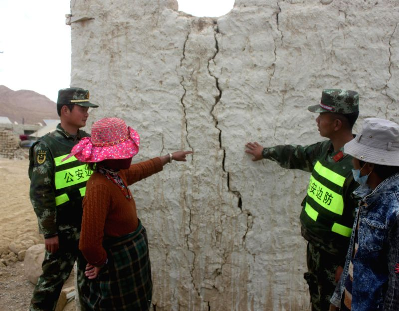 XIGAZE, May 22, 2016 - Soldiers examine house damages after an earthquake hit Dinggye County of Xigaze City, southwest China's Tibet Autonomous Region, May 22, 2016. Two 5.3-magnitude earthquakes hit ...