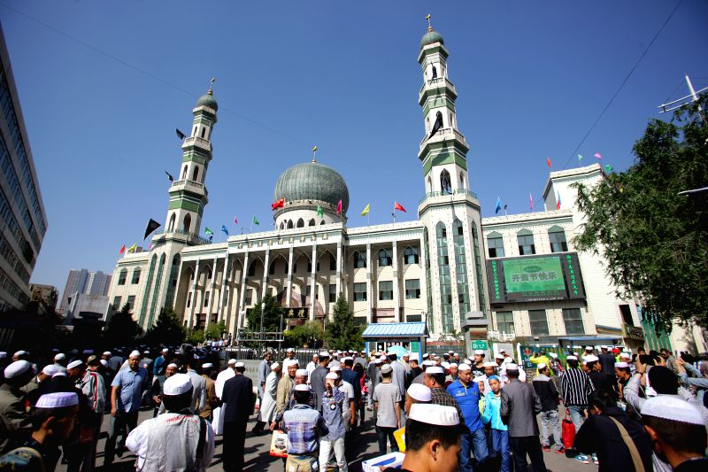 Muslims leave Dongguan Mosque after a prayer gathering in Xining, capital of northwest China's Qinghai Province, July 28, 2014. Muslims across the province gathered .