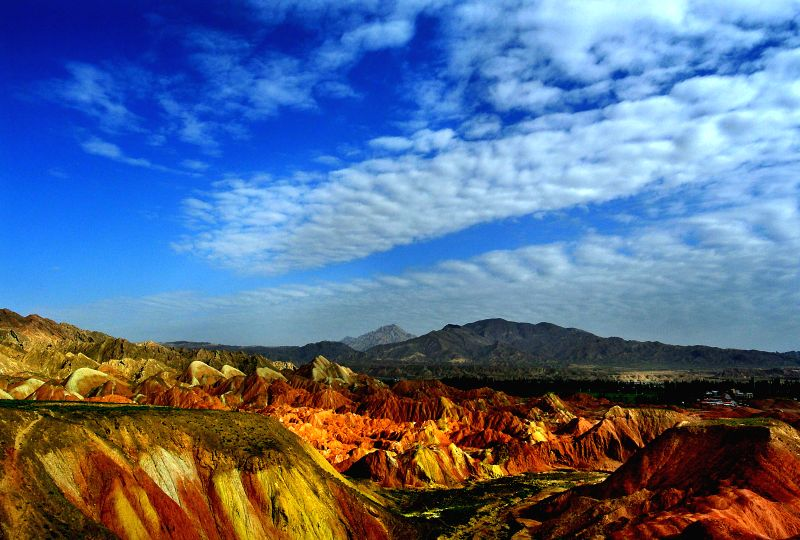 Photo taken on July 7, 2014 shows the scenery at Zhangye Danxia Landform Geological Park in Zhangye City, northwest China's Gansu Province. Danxia, which means ...