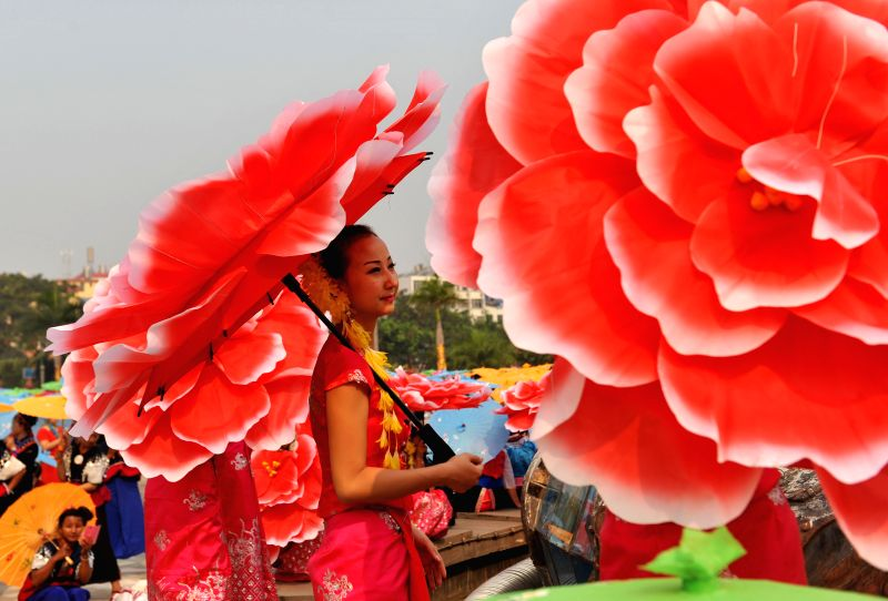 Girls of the Dai ethnic group perform at a celebration of the Water-sprinkling Festival in Jinghong City, southwest China's Yunnan Province, April 14, 2014. .