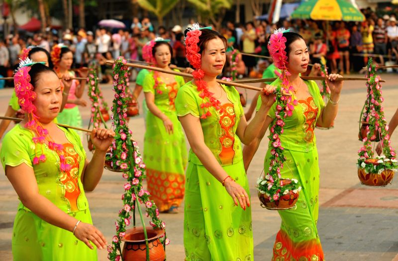People of the Dai ethnic group perform at a celebration of the Water-sprinkling Festival in Jinghong City, southwest China's Yunnan Province, April 14, 2014.