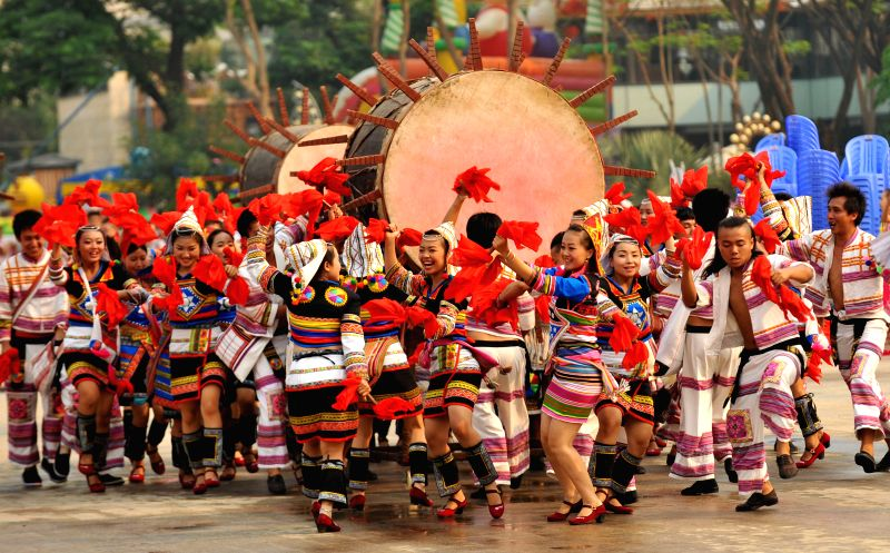 People of the Jinuo ethnic group perform at a celebration of the Water-sprinkling Festival in Jinghong City, southwest China's Yunnan Province, April 14, ...