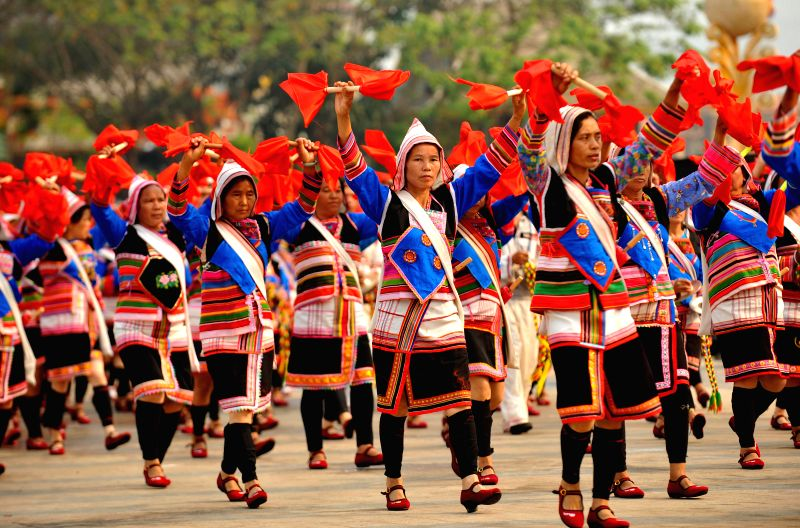 Women of ethnic groups perform at a celebration of the Water-sprinkling Festival in Jinghong City, southwest China's Yunnan Province, April 14, 2014. The ...