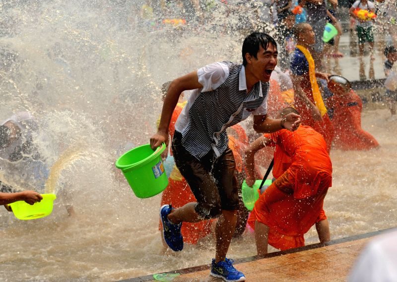 Locals and tourists have fun with water during the Water-splashing Festival in Jinghong City of Dai Autonomous Prefecture of Xishuangbanna, southwest China's .