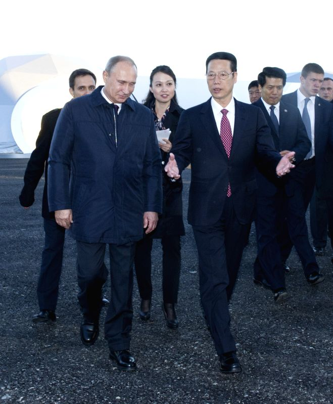 Chinese Vice Premier Zhang Gaoli (R, front) and Russian President Vladimir Putin (L, front) attend a start-of-construction ceremony of the Russian part of the ...