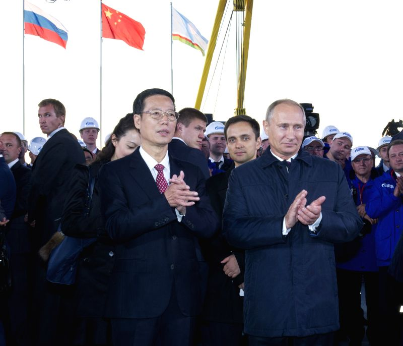 Chinese Vice Premier Zhang Gaoli (L, front) and Russian President Vladimir Putin (R, front) attend a start-of-construction ceremony of the Russian part of the ...