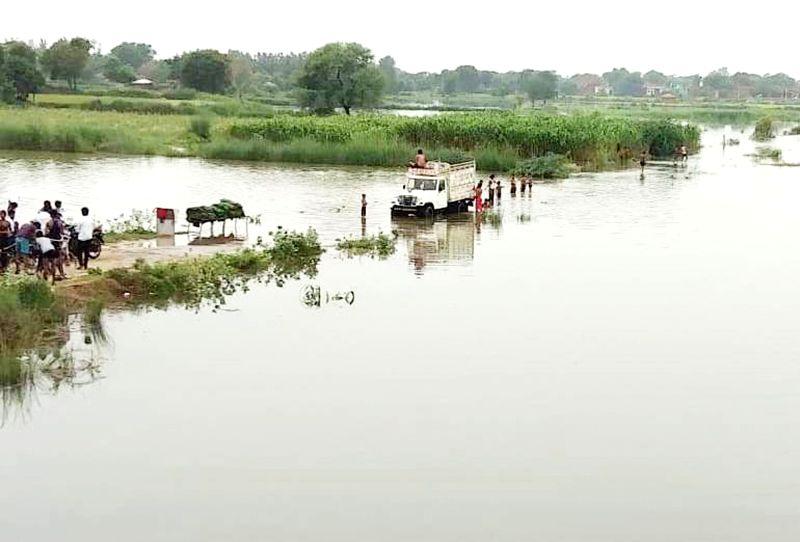 Yamuna waters inundate villages in Naujhil area near Mathura in Uttar Pradesh, on July 31, 2018.