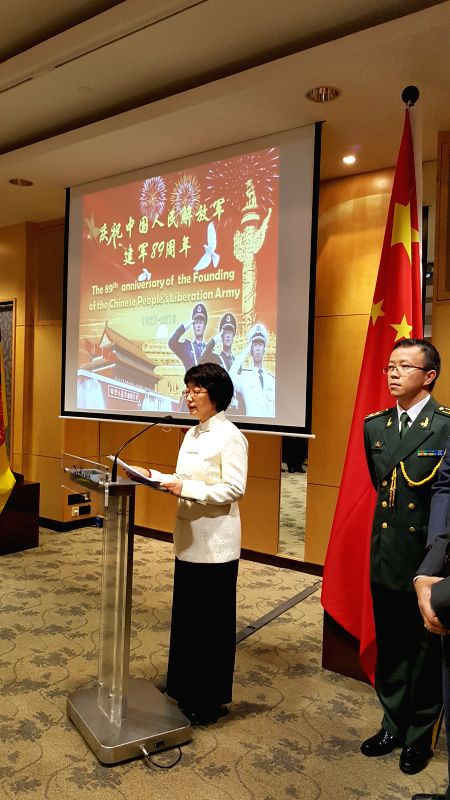 Yang Jian (L), Chinese ambassador to Brunei, delivers a speech during the reception to celebrate the 89th anniversary of the founding of the Chinese ...