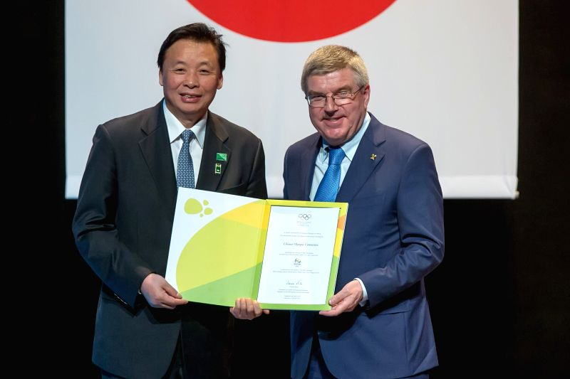 Yang Shu'an (L), vice president of Chinese Olympic Committee(COC), accepts an invitation letter on behalf of COC from Thomas Bach, president of the ...