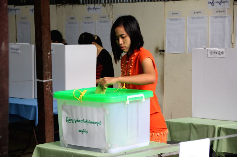 : YANG0A woman casts her ballot at a polling station in Yangon, Myanmar, Nov. 8, 2015. Myanmar's multi-party general election began across the country Sunday morning ...