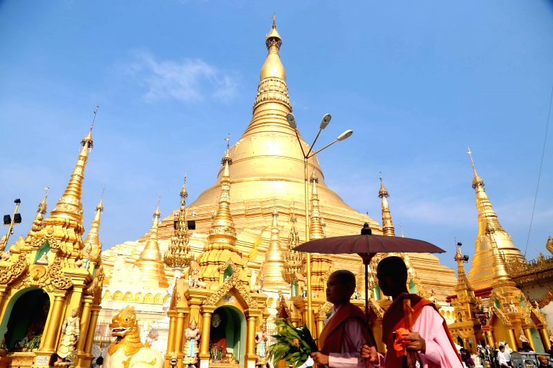 Nuns carry flowers to offer on the first day of Myanmar's traditional new year at the Shwedagon Pagoda in Yangon, Myanmar, on April 17, 2014.