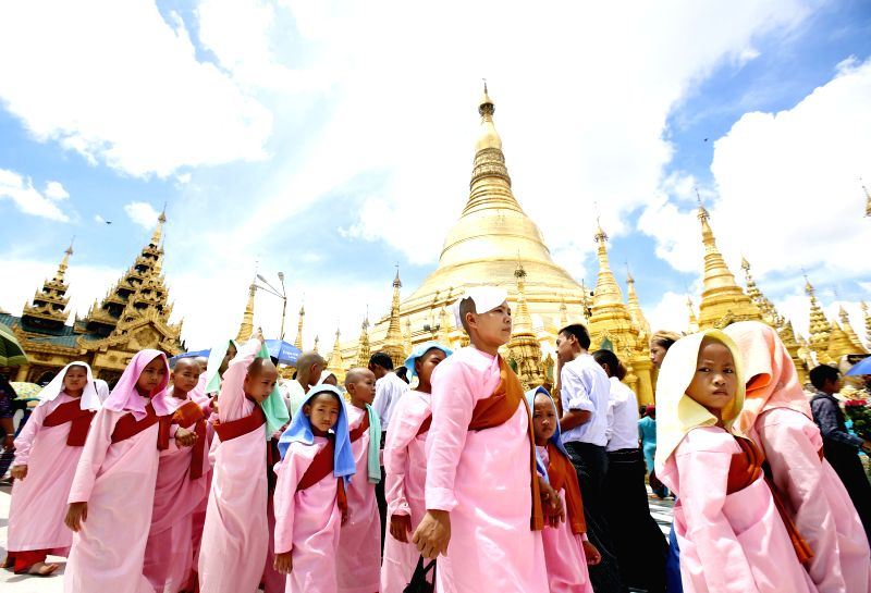 YANGON, April 17, 2017 - People visit Shwedagon Pagoda on the first day of Myanmar's traditional new year in Yangon, Myanmar, on April 17, 2017. (Xinhua/U Aung)