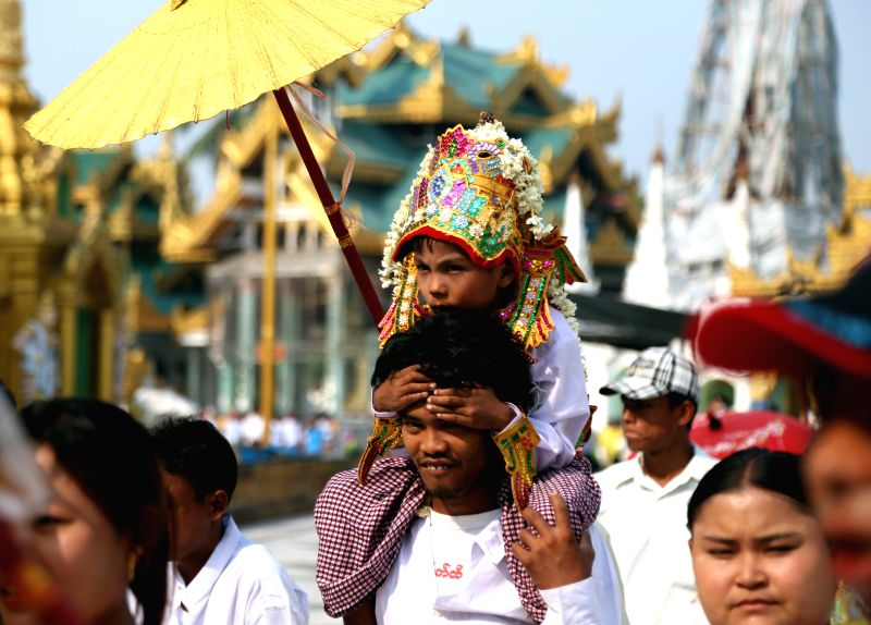 A young boy in traditional attire parades during the Shin Pyu, an essential and integral part in a life of a Myanmar Buddhist male under the age of 20, at Shwedagon ...