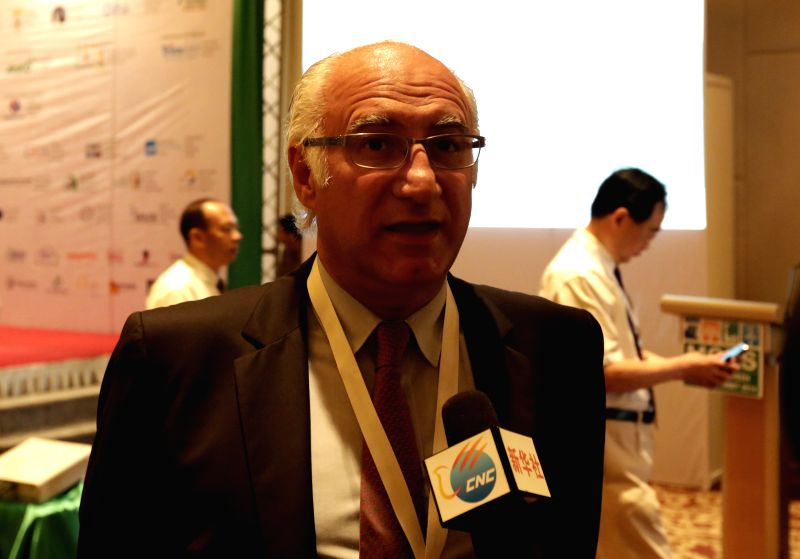 Michel De Vivo, Secretary general of International Commission on Large Dams, replies to media at  the opening ceremony of Myanmar Green Energy Summit 2014 in Yangon, .