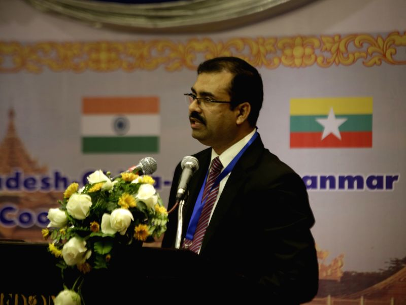 Bangladesh delegation leader and foreign ministry official Abdul Motaleb delivers a speech during the opening ceremony of the 12th forum of Bangladesh, China, India .