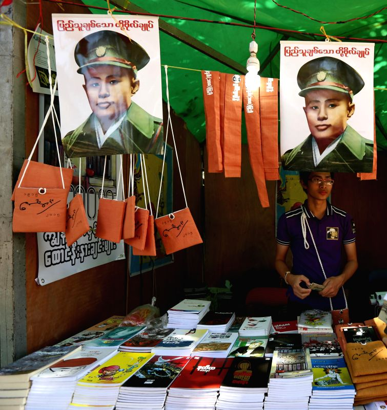 Photo taken on Feb. 13, 2015 shows the pictures and biography books of General Aung San displayed for sale at a souvenir and book shop during the centennial ...