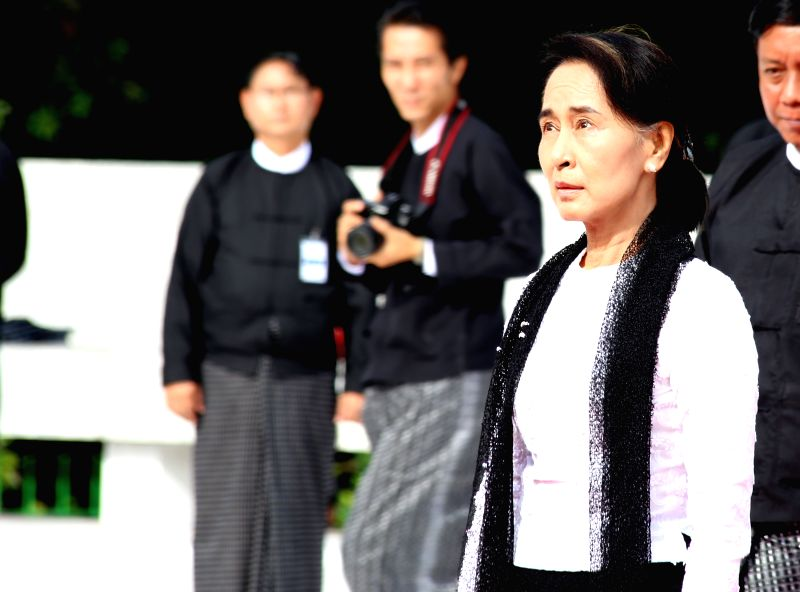 Aung San Suu Kyi (front), daughter of Aung San, looks at the Martyrs' Mausoleum before salute during the 67th Martyrs' Day ceremony in Yangon, Myanmar, July 19, ...