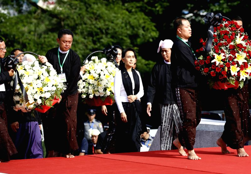 YANGON, July 19, 2016 - Myanmar's State Counselor Aung San Suu Kyi (C), daughter of General Aung San, pays tribute during a ceremony to mark the 69th Martyrs' Day in Yangon, Myanmar, July 19, 2016. ...