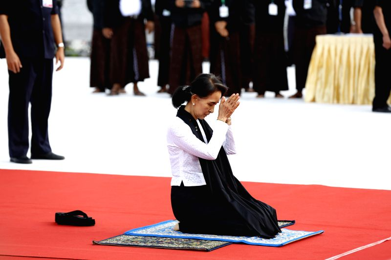 YANGON, July 19, 2016 - Myanmar's State Counselor Aung San Suu Kyi, daughter of General Aung San, pays respect during a ceremony to mark the 69th Martyrs' Day in Yangon, Myanmar, July 19, 2016. ...