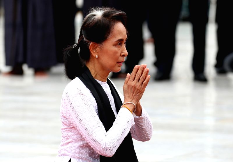 YANGON, July 19, 2018 - Myanmar's State Counselor Aung San Suu Kyi, daughter of General Aung San, pays tribute during a ceremony to mark the 71st Martyrs' Day in Yangon, Myanmar, July 19, 2018. ...