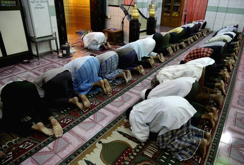 Muslims pray at a mosque during the holy month of Ramadan in Yangon, Myanmar, July 1, 2014. Muslims around the world celebrate Ramadan, the holiest month in the ...
