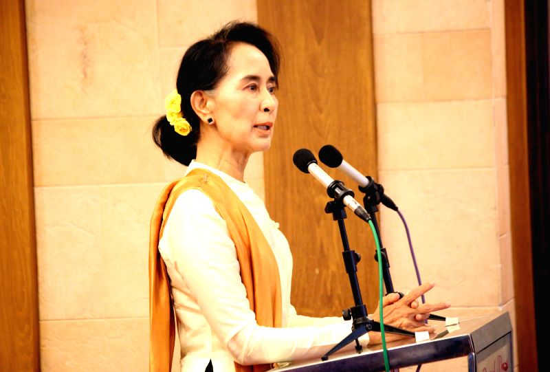 Myanmar opposition leader Aung San Suu Kyi delivers a speech during the opening ceremony of the nationwide youth conference for National League for Democracy (NLD) in