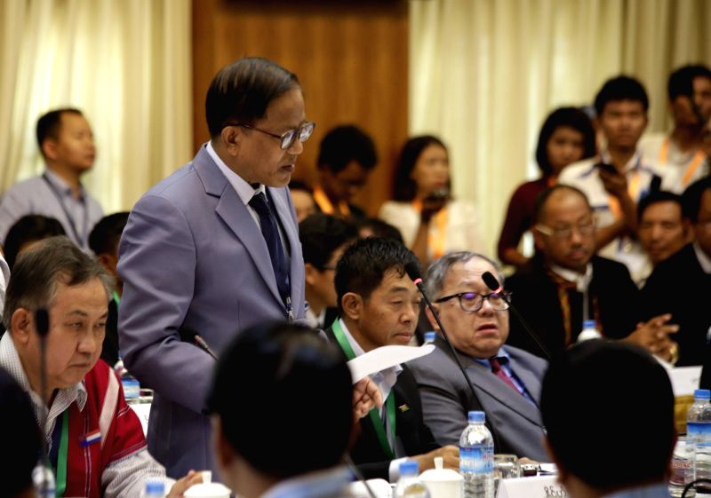 Leader of the ethnic armed groups' National Ceasefire Coordination Team (NCCT) U Naing Han Tha speaks during a formal peace talk resumed at the Myanmar Peace Center ...