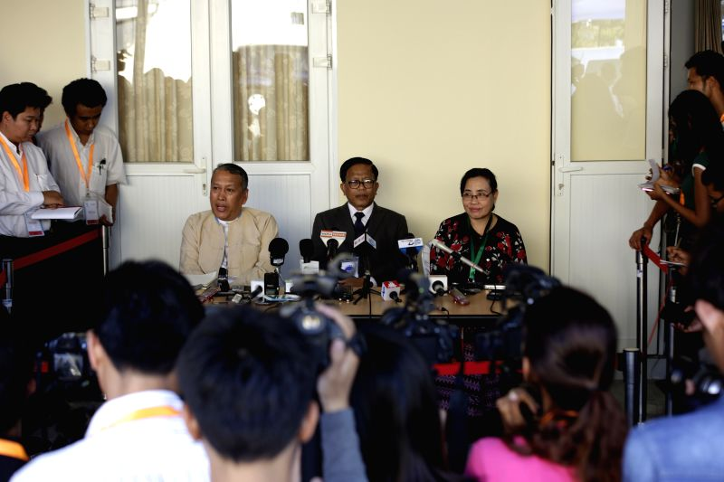 Members of Myanmar government's Union Peace-Making Work Committee (UPWC) and the ethnic armed groups' National Ceasefire Coordination Team (NCCT) attend a press ...