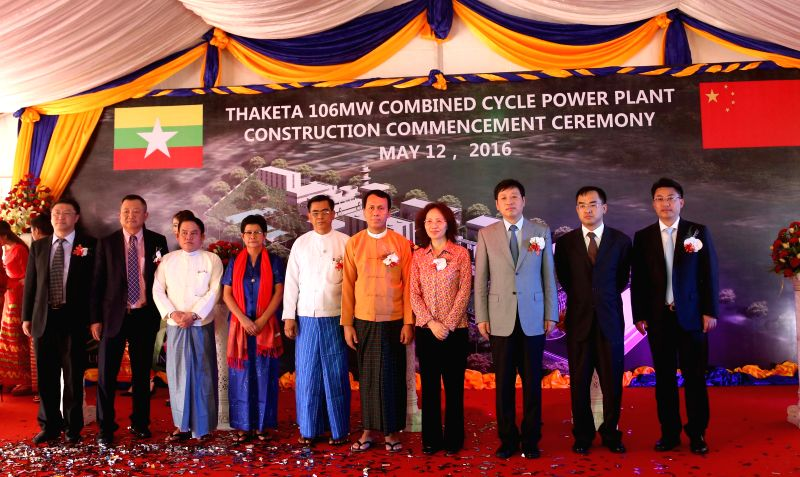 YANGON, May 12, 2016 - Guests pose for a group photo at the ribbon-cutting ceremony in Yangon, Myanmar, May 12, 2016. China-Myanmar JV companyUnion Resources and Engineering Company limited ...