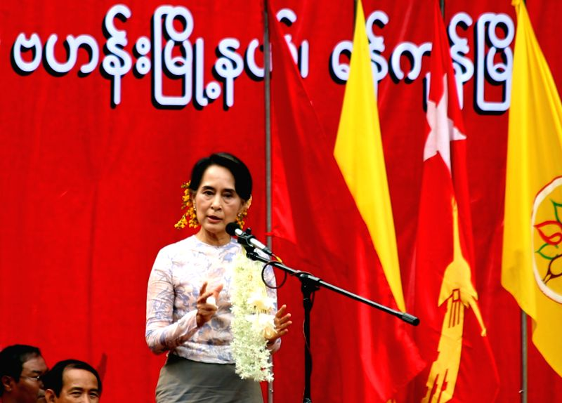 Leader of Myanmar opposition party National League for Democracy Daw Aung San Suu Kyi delivers a speech during the first-ever public campaign between NLD and the 88 ..