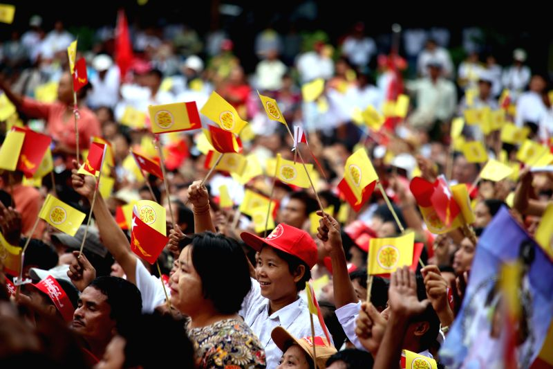 People attend a public compaign in Yangon May 17, 2014. Leader of Myanmar's opposition National League for Democracy party Daw Aung San Suu Kyi called Saturday on the