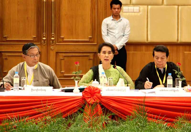 YANGON, May 27, 2016 - Myanmar's State Counselor Aung San Suu Kyi (C) speaks at a meeting of the Union Peace Dialogue Joint Committee (UPDJC) in Nay Pyi Taw, Myanmar, May 27, 2016. The UPDJC in ...