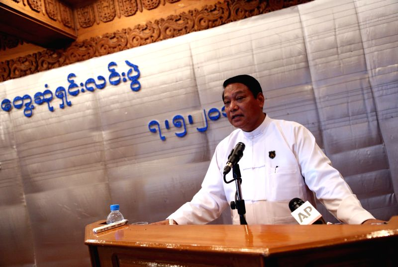 Myanmar Minister for Immigration and Population U Khin Yi speaks at a press conference in Yangon, Myanmar, May 7, 2014. Myanmar authorities will release the ...