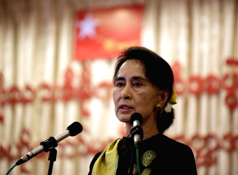 Myanmar's opposition National League for Democracy (NLD) leader Aung San Suu Kyi delivers a speech during the opening ceremony of the Central Committee meeting for the NLD in Yangon, Myanmar,