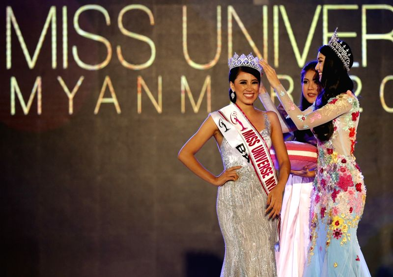 YANGON, Sept. 30, 2017 - Hnin Thway Yu Aung (L) receives the crown after winning the Miss Universe Myanmar 2018 pageant in Yangon, Myanmar, Sept. 30, 2017. Miss Universe Myanmar on Saturday crowned ...