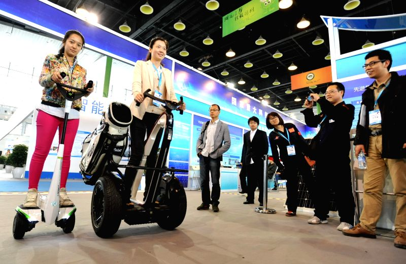 A six-leg robot is displayed at an exhibition on science and technology cooperation in Yangzhou, east China's Jiangsu Province, April 18, 2014. The exhibition, ...