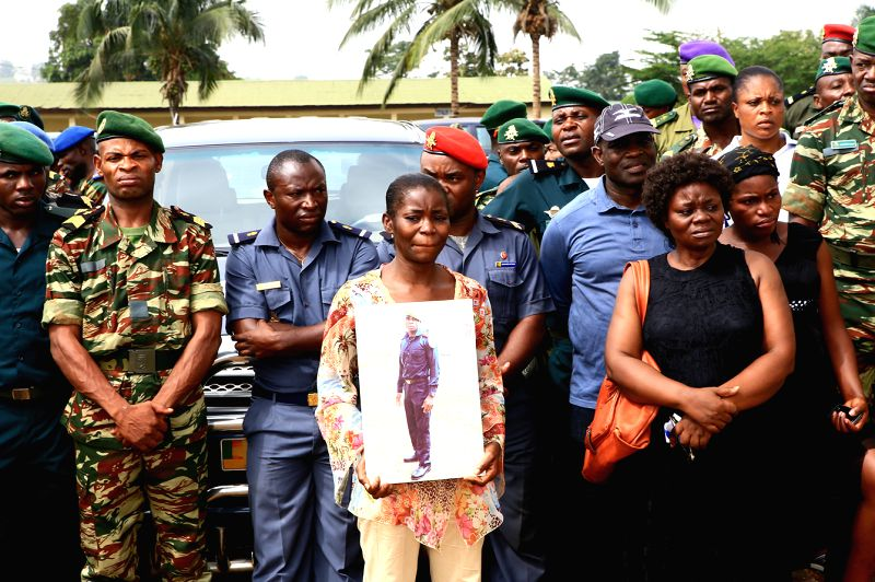 A woman holds a picture of one deceased soldier in Yaounde, Cameroon, March 6, 2015. The Cameroonian government handed over the bodies of 39 soldiers, out of which ... - Edgar Alain Mebe Ngo