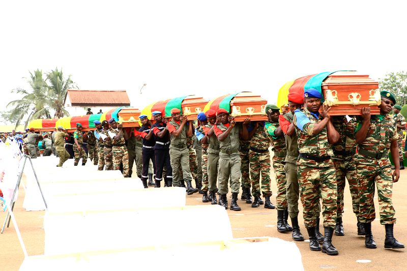 Soldiers carry the coffins of the deceased members in Yaounde, Cameroon, March 6, 2015. The Cameroonian government handed over the bodies of 39 soldiers, out of ... - Edgar Alain Mebe Ngo